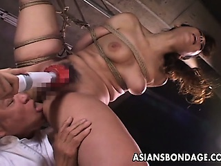 Abnormal Asian indulge in bondage receives a nasty dildo