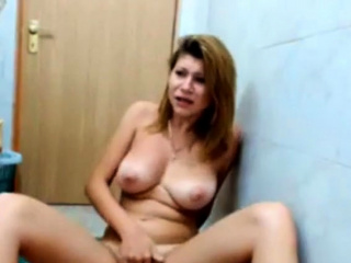 busty teen masturbates in bathroom with her parents at home